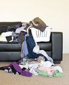 image of dirty-laundry  - Housework concept of a large pile of laundry dumped on the couch waiting to be folded and put away - JPG