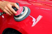 stock photo of suds  - Hand with a Machine polishing the car - JPG