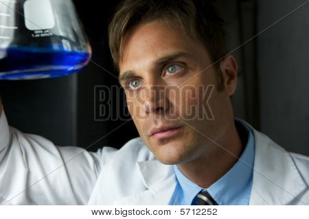 Young Scientist Performing Experiment