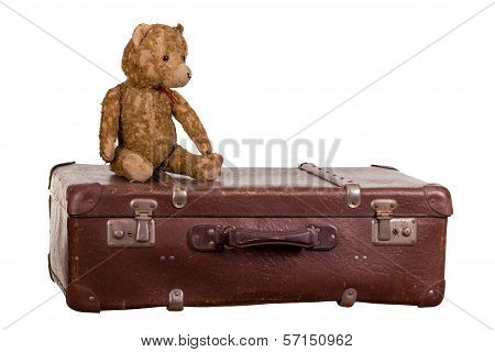 Old Teddybear Sitting On Suitcase