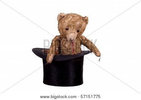 Old Teddybear Sitting In Old Black Hat