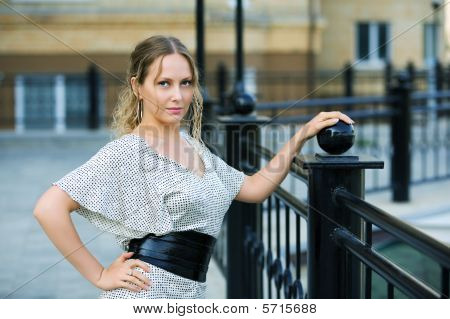 Beautiful Woman Against A Railing.