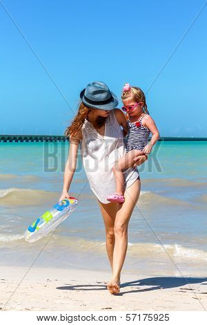 Mom Daughter Having A Walk At The Beach