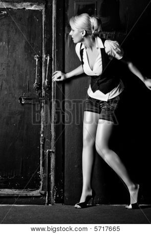 Young Woman Slinking To The Door