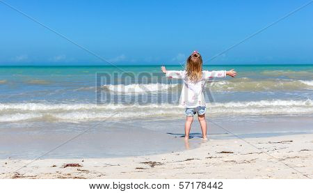 Girl Staring  At The Ocean