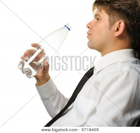 The Businessman Drinking Water From A Bottle