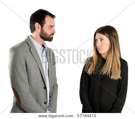 Young Couple Doing A Joke Over Isolated White Background