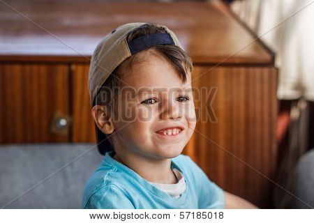 Happy Little Boy In Cap