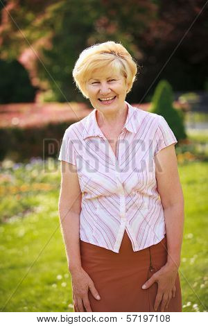 Elegance. Elation. Happy Senior Woman Outside With Toothy Smile
