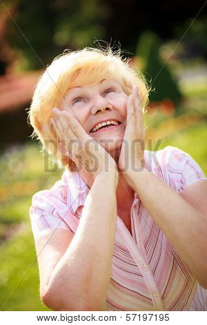Elation. Ecstasy. Surprised Glad Grey-haired Senior Woman Looking Up