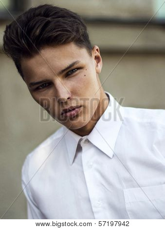 Ambition. Serious Attractive Charismatic Man In White Shirt