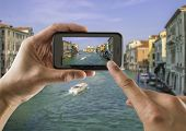 Tourist Holds Up Camera Phone At The Grand Canal