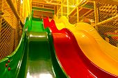 foto of swingset  - Modern playground with colorful slides. Colored background.
