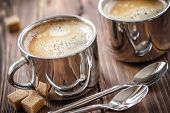 picture of latte  - Two coffee cups on a wooden table - JPG