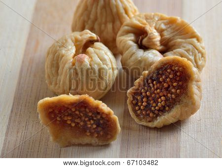 exotic dried fig fruits on old wooden table
