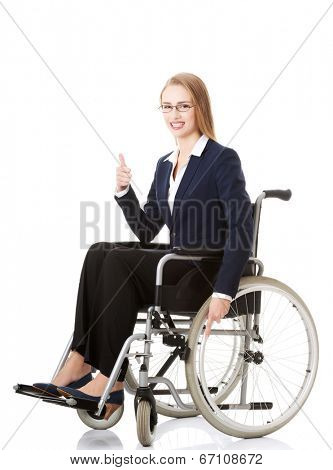 Beautiful caucasain business woman sitting on wheelchair. Isolated on white.