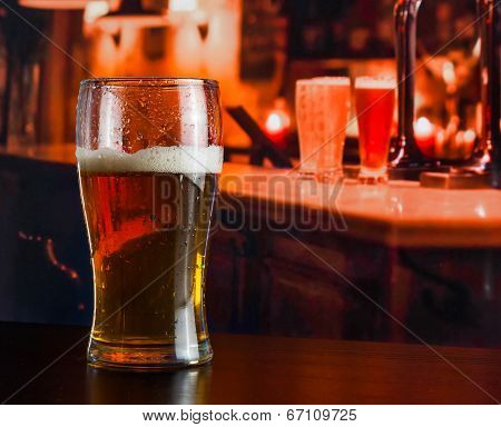 Glass Of Fresh Beer On Wood Table