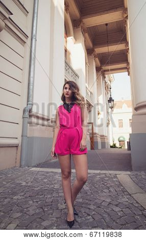 Fashion, Glamorous And Attractive Woman Dressed In A Sexy Sleeveless Pink Jumpsuit Walking On Imagin