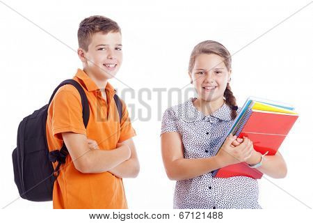 Happy school kids standing isolated on white background