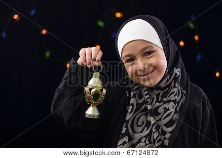 Happy Muslim Girl Celebrating With Ramadan Lantern