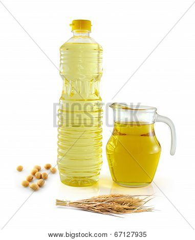 Rice Bran Oil In Bottle Glass With Seed And Soy On White Background
