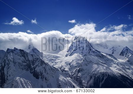 Mountain Peaks In Clouds