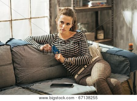 Thoughtful Young Woman With Credit Card And Tablet Pc Sitting On