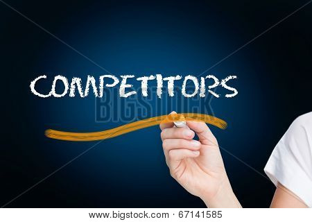 Businesswoman writing the word competitors against blue background with vignette