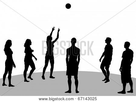 Young athletes playing volleyball on beach