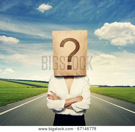 businesswoman with big question on the paper bag
