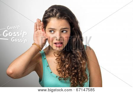 Nosy girl with the hand on her ear secretly hearing a private conversation