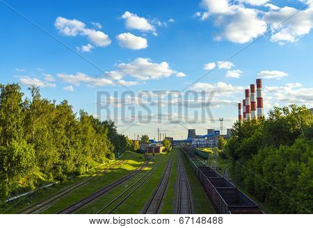 Railway Tracks Junctions Near Power Plant Chimneys