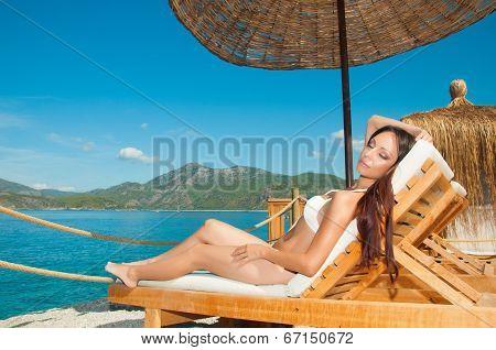 Girl Sunbathing In Vip Bungalow Overlooking The Sea
