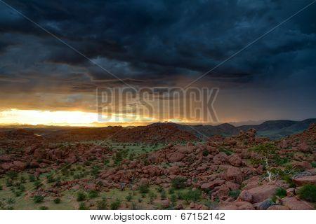 Sun Rising Behind A Thunderstorm