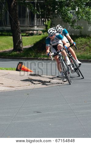 Cycists Turn Corner At Stillwater Criterium
