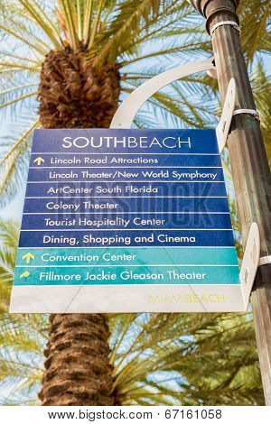 MIAMI,USA - MAY 20,2014 : Street sign with directions to tourist landmarks in South Beach, Miami
