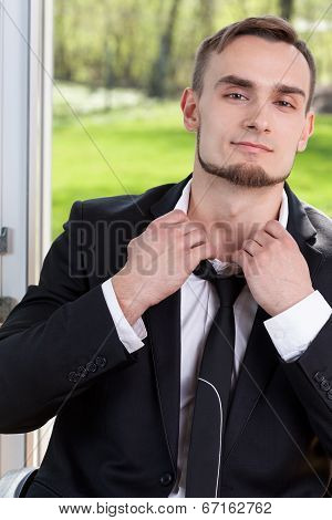Businessman Loosing His Tie