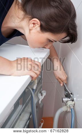 Housekeeper Having Problem With Washing Machine