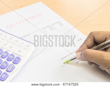Close Up Fingers  Holding A Pen To Sign On  Document