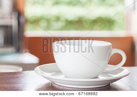 Cup Of Coffee On Wooden Counter