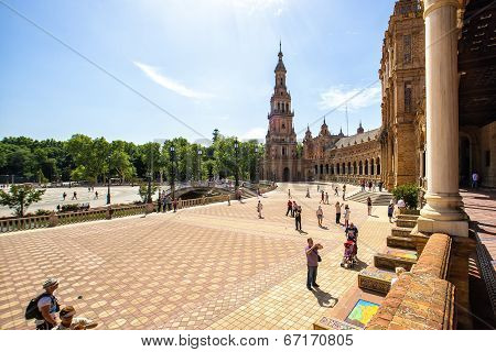 SEVILLE, SPAIN - MAY 07: Tourists in the Spain Square of Seville on May 02, 2014 in Seville.