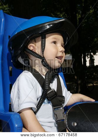 Small Boy On Bicycle Seat.