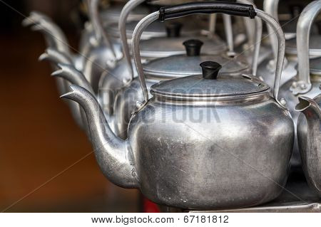 Small Classic Kettle In Row.