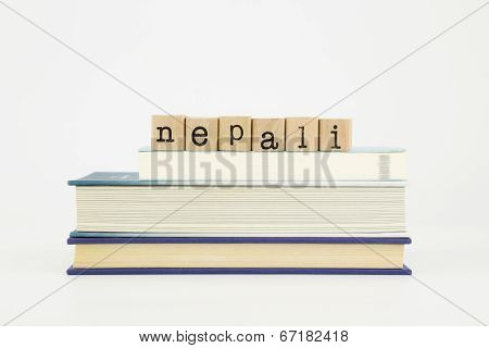 Nepali Language Word On Wood Stamps And Books