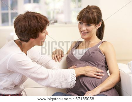 Pregnant woman talking to midwife