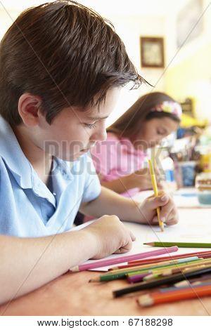 Pre teen children in art class