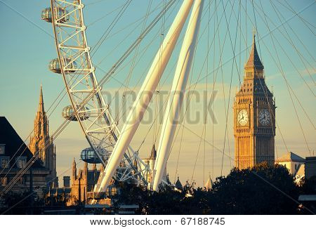 LONDON, UK - SEP 26: London Eye and Big Ben on September 26, 2013 in London, UK. It is Europe's tallest Ferris wheel and the most popular paid tourist attraction in UK
