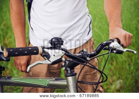 Cyclist Holds Handlebar Of Bicycle