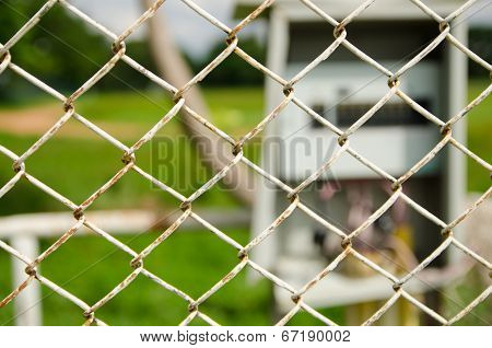 Wire Fence With Electrical Control Box On Background