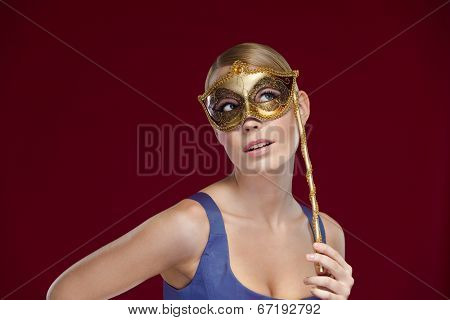 Pretty woman with masquerade masque, isolated on purple